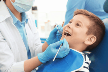 children's dentistry boy in dental chair