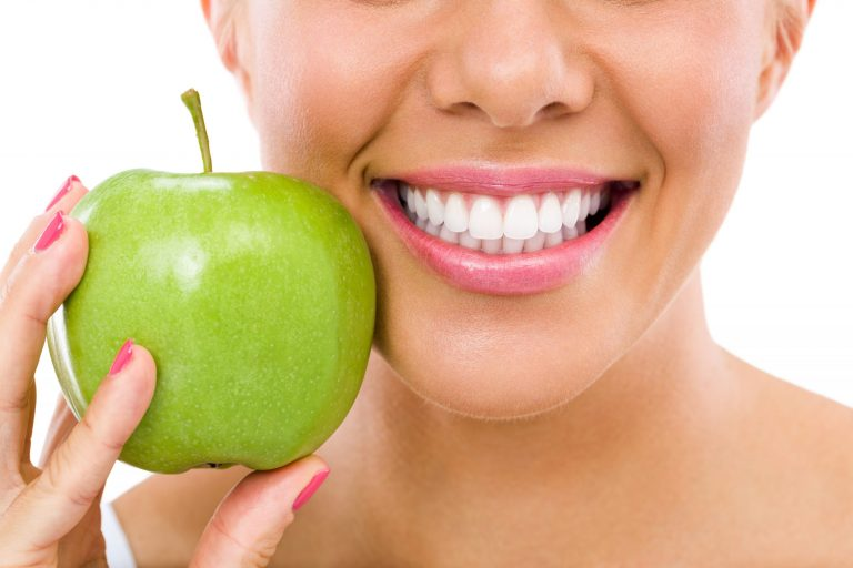 gorgeous smiling lady with green apple