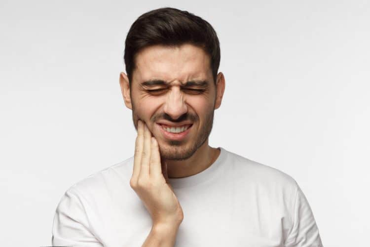 man in pain needing dentist
