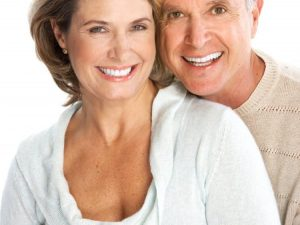 older couple with white smiles